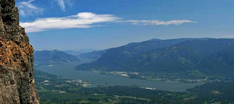 The cliff face of Table Mountain with the Columbia River Gorge in the distance